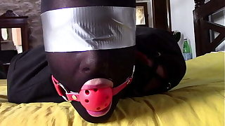 Laura XXX is enervating panthyhose increased by high heels. She's hogtied, masked, blindfolded increased by ballgagged
