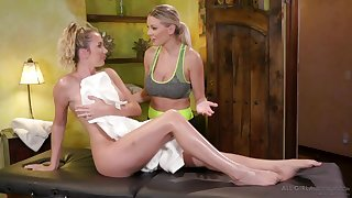 Two busty blondes are jilling in perpetuity others pussies on the massage table